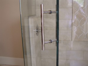 Custom door pull for frameless shower enclosures