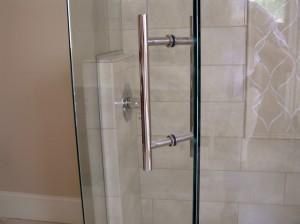 Custom door pull for frameless shower enclosures